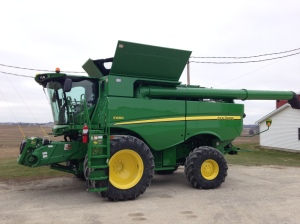 The new 2014 JD S680 combine on the day it was delivered.  Clean as a whistle, just the way we like it!