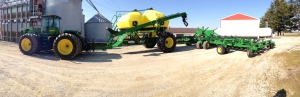 Here's a panoramic shot of the soybean planting system.  JD 9330 tractor, JD 1910 air cart, and JD 1890 50-foot no-till air drill.