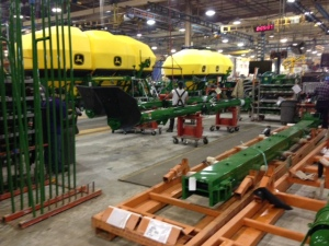 Here you see some 550-bushel air carts moving along their assembly line on the east side of the Valley City plant.  In the staging area in the foreground, you see the loading augers or conveyors waiting to be installed.