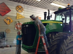 Nick and Brandon are putting a coat of wax on the JD 9330... brilliant!