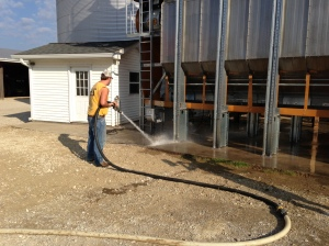 Pretty routine stuff, but after Ben washed down the entire structure of the dryer, John washes the concrete underneath.