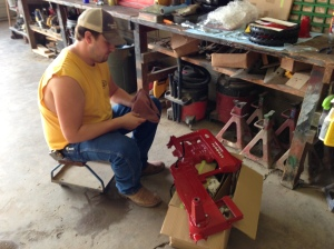 John works on the Farmall 400 pedal tractor