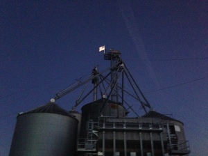 In the early dawn, Old Glory flies above the Carnahan & Sons family farm.