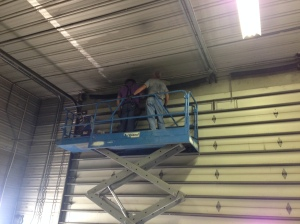 They guys from DC Metal work to get the big overhead shop door fixed today.