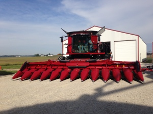 Ross has his new CIH 4412F corn head connected for the first time.  He's testing the height and tilt controls.