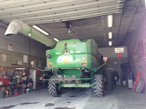 On this day-after-the-rain, the JD S680 combine gets its first oil change.