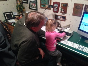 Ella likes to push the buttons on the calculator (In the past I would have called it an adding machine!)