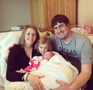 Here's the happy family... Ashley and John with daughters Ella and new little Molly.
