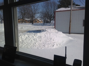 Looking out from the office desk, you can see the snow-pile created by clearing a path to the fuel building.