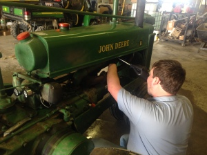 John is repairing or replacing some of the old leaky radiator hoses.