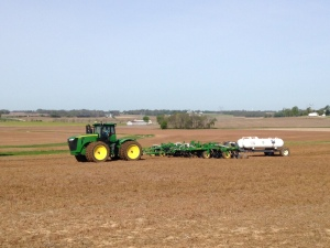 John is in the JD 9360R tractor with the 60-foot 2510H applicator, applying nitrogen fertilizer for the corn crop.