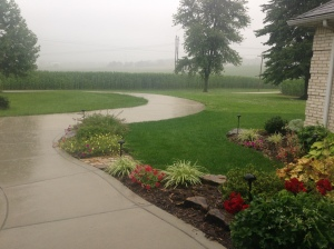 Looking out the front door, you can see the rain pouring down.