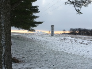 The old silo stands sentinel as a reminder of those cold mornings long ago when we had to fork down silage to feed the calves.  In the distance, you can see the steam from the power plant at Petersburg, Indiana.  The white blanket brings a 'hush' to the countryside, especially in the evening.