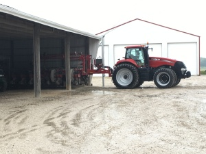 The MX290 has the corn planter under roof on this rainy day.  Better days are coming.