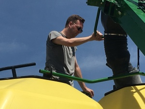 Philip helped me fill the air drill with soybean seed on Monday