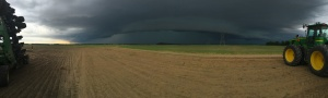 Just as I was folded up and ready to leave the field at Freddie, I stepped out of theJD 9330 tractor and snapped this panorama of the approaching storm...