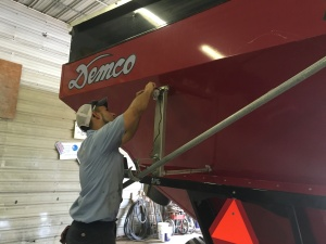 Brandon installs the camera on the back of the grain cart.  It is a necessity when traveling on the highway.  It allows the operator to see what's approaching from behind!