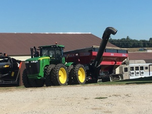 The JD 936R tractor with Demco 1350 grain cart is ready to go, too.