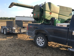 Larry fills the fuel tank of the S680 combine