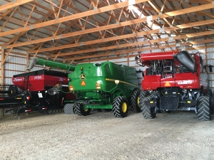 The 680 takes its place along the back wall of the big storage building, between the grain cart and the 8230 combine.