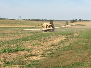 The acres disappear rapidly behind this machine. The farmer feels the 'ka-ching!' of the rapidly growing fertility bill, too!