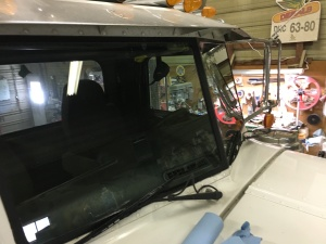 While he was routing the wiring harness on the Pete, I took the occasion to scrub the windshield. It had countless bugs to clear away! The 'after' shot looks much better, and the view from the seat is much improved.