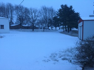 Looking out from the farm office, we see the snow packed on the driveway.
