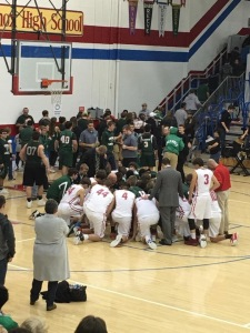 After Lincoln defeated our Spartans, the two rival teams gathered together for prayer.  Pretty touching for this old guy, and maybe an example for the country, too.